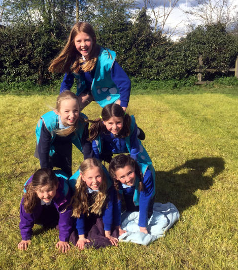 Human pyramid, outdoors at Cirencester after school club.